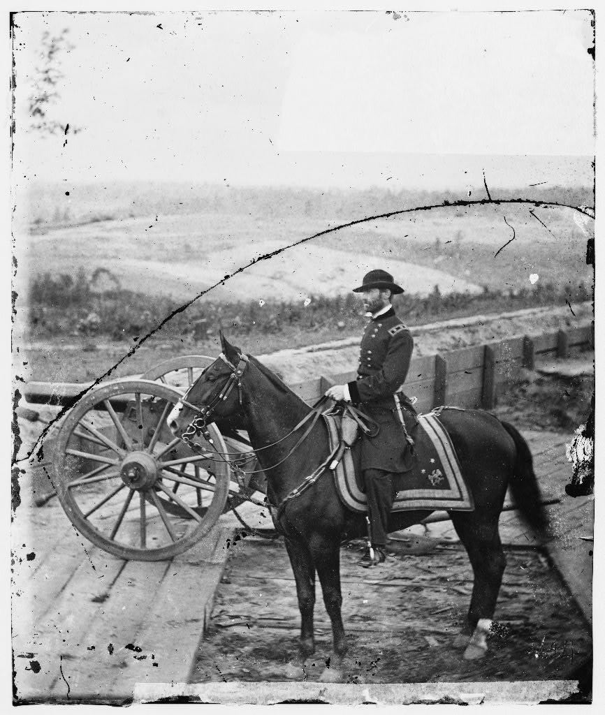 Black and photo of William T. Sherman on horseback.